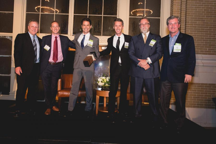 Crescent Real Estate's McKinney & Olive development and design team accepts UIL Innovation Award.