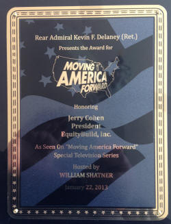"""Moving America Forward"" Award by Retired Rear Admiral Kevin F. Delaney."