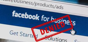 """A """"Denied"""" ruling is stamped on an image of a Facebook ad solicitation page"""