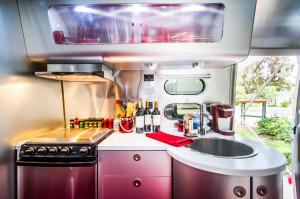 Inside Airstream photo of kitchen