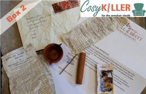 Box two of cosykiller contains a folded cigarette card, letter, burned diya, and some other intreguing objects
