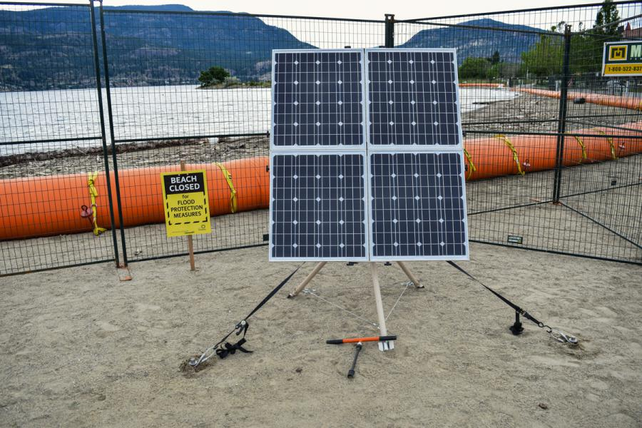 Solar system setup on beach with flood barriers