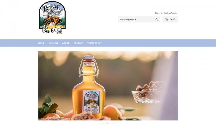 Flip-top bottle of Register Family Farm tupelo honey sitting on a picnic table in the sun