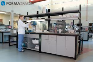 Lab technician using lab equipment