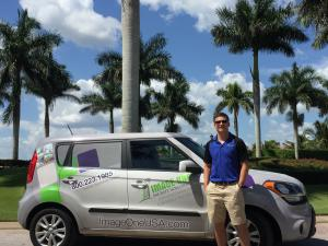 Nikko Conn, owner of Ft. Myers-based Image One franchise, stands in front of a work vehicle.