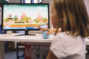 Girl playing SimyGames with the biofeedback game controller SimyBall