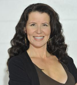 Head shot of TV host and producer Tammy-Lynn McNabb wearing brown and black top