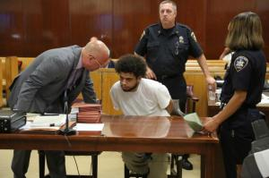 Deron Castro in the courtroom with a client (Mr. Castro and Mr. Patrick Megaro often cooperated in cases)
