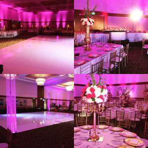 Dance floor surrounded with crystal columns, uplighting for a romantic feel and gold chiavari chairs for the ballroom