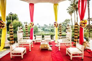 Red and yellow draping in the hotel outdoor garden with furniture rentals