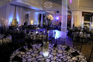 Hints of blues for a black and white wedding reception. Lighted crystal columns surround the dance floor for a bedazzling affect.