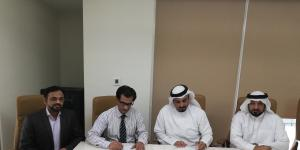 Sultan Lootah and Shabbir Hussain While signing the agreement